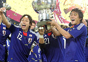 Japan team members celebrate with the AFC Asian Cup trophy after winning the final match against Australia 1-0 in Doha, Qatar.